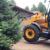 В Новокузнецком районе тракторист, чуть не задавивший человека, повредил гараж и жилой дом